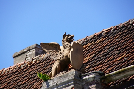 Old sculpture on a roof of the house