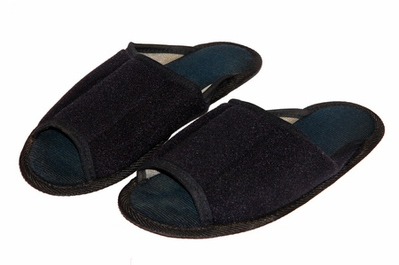 A pair of black slippers on a white background  Stock Photo - 16246933