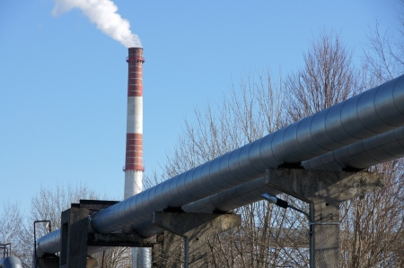 Industrial pipes on a background of the blue sky