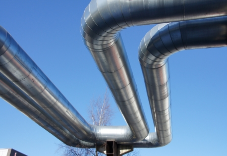 Bend of industrial pipes on a background of the sky