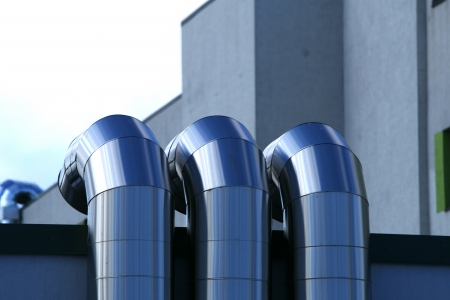 Metal pipes are located in one line Stock Photo