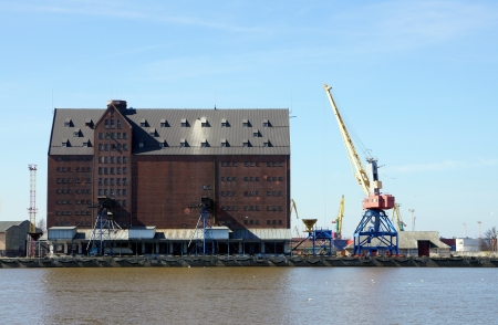 Port granary on a background of the blue sky
