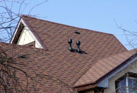 roofing: Brown roof on a background of the sky