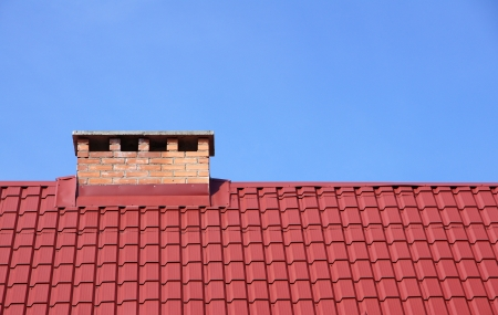 The roof and chimney with blue sky Stock Photo