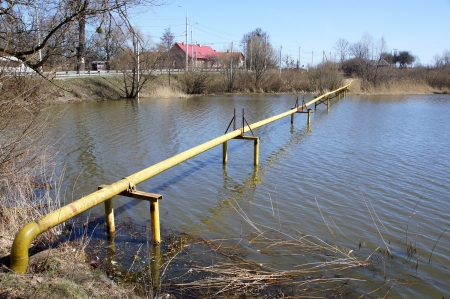 The yellow gas pipeline is above water Stock Photo