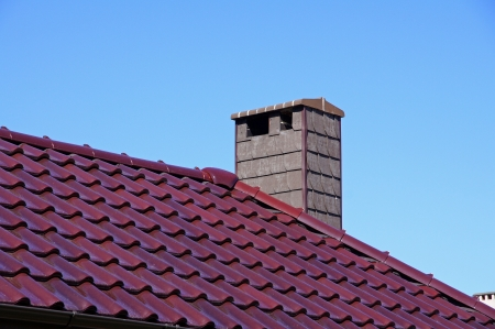 Chimney on a background of the sky Stock Photo
