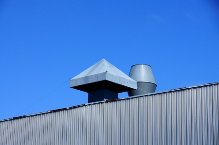 Pipes of ventilation on a background of blue sky Stock Photo