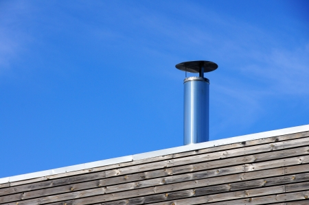 Vents of ventilation are located on a roof of a  building Stock Photo