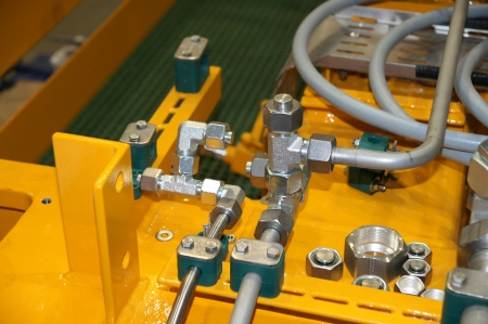 Hydraulic details on a yellow background