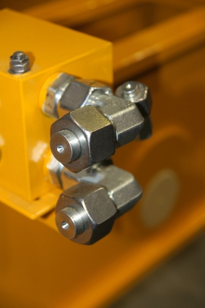 The nuts with plugs are located on the yellow detail  Banco de Imagens