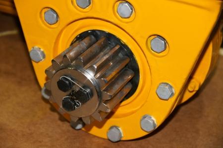 The cogwheel on the mechanism of yellow color