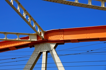 bridge construction: Beams of the bridge on a background of the blue sky Stock Photo