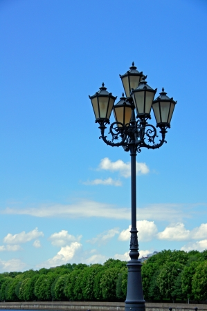 Lantern on a background of the sky and trees