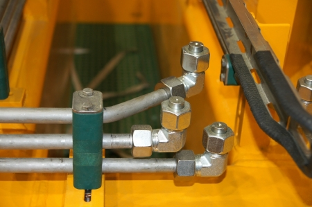 Connection hydraulic pipes and nuts with plug  Stock Photo