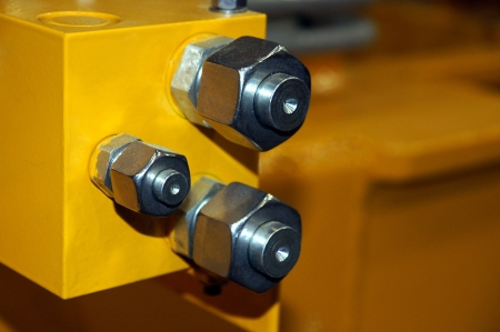 The nuts with plugs are located on the yellow detail  Stock Photo
