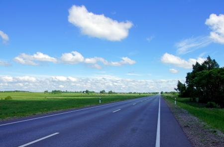 Landscape with road and the cloudy sky