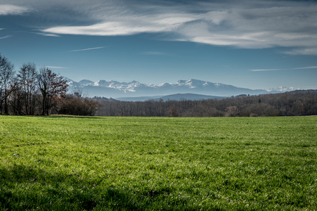 Snow capped mountains of the Midi Pyreneese set against green, grassy fields give the feeling of wide open spaces.