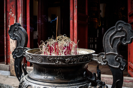Incense burning outside The Temple of the Jade Mountain is on Hoan Kiem Lake in Hanoi, Vietnam.