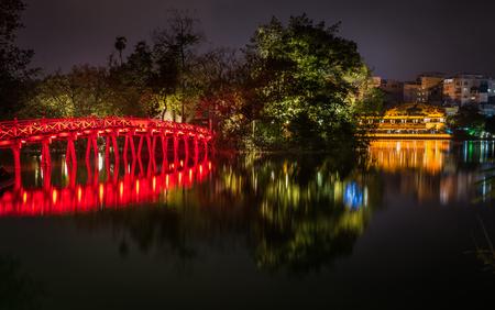 Night cityscape of Hanoi Vietnam from Hoan Kiem Lake.