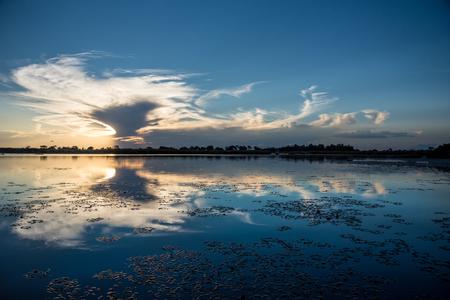 Sunset over the water on the Okavango Delta Botswana Imagens