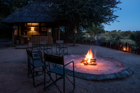 Evening around the boma camp fire at an african safari lodge Stock Photo