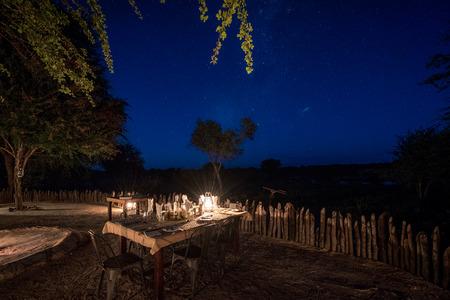Dinner under the night sky at a luxury safari lodge in Botswana Africa