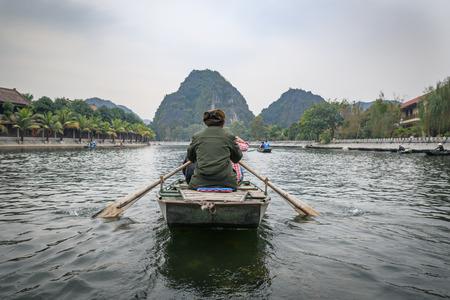 Rowing traditional bamboo boats in Tam Coc Ninh Binh Vietman