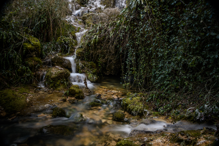 Roquefort Cascades France frozen waterfall in lush forest in France