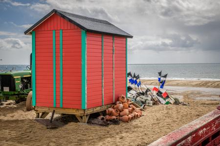 Fishing boats and brightly coloured beach shacks in Huelva spain.