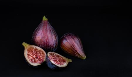 Ripe fresh figs against black backdrop