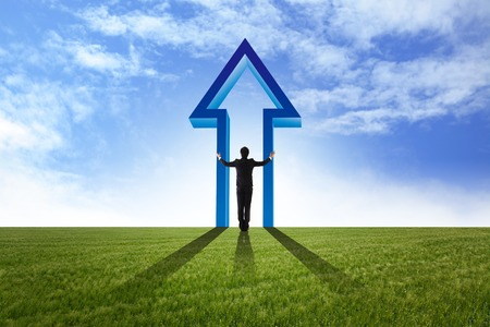 business man stand on the field and watch growth graph photo