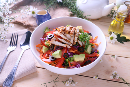 avacado: Grilled chicken salad with avacado, baby romaine, cabbage, carrots, tomatoes and black olives.