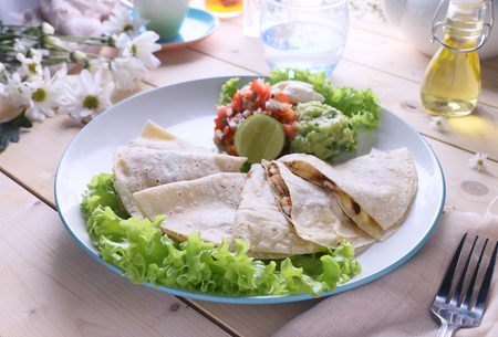Chicken wrap served with lettuce on a white plate. Stock Photo