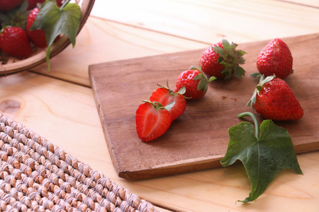 Sliced strawberries on a chopping board. Stock Photo