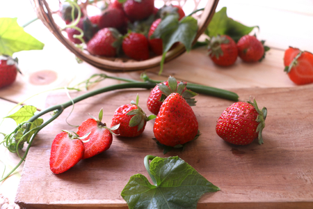 Red strawberries on a chopping board. Stock Photo