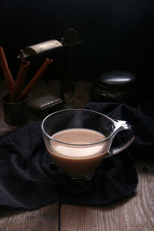 Tea in cup with dark antique background.