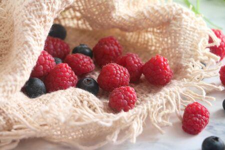 Fresh Raspberries and Blueberries in a sack
