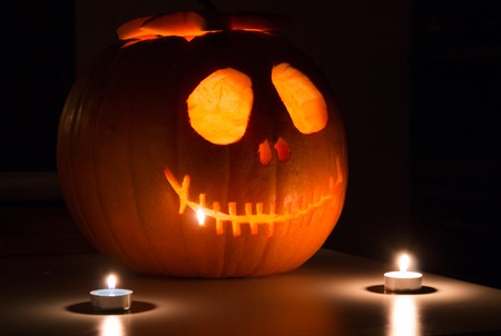 Scary Halloween pumpkin with candels. Scary glowing face trick or treat Stock Photo