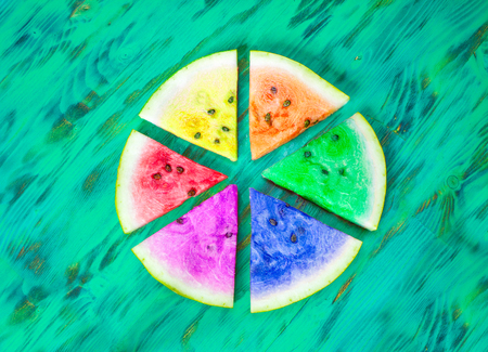 Watermelon slices. lgbt concept. Green wooden background. View from above