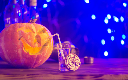 Halloween party. Funny Pumpkin with a cocktail and cookie. selective focus Stock Photo