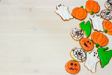 Funny delicious ginger homemade biscuits for Halloween on the table. horizontal view from above. Halloween cookies