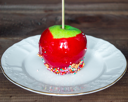 candy apples with confectionery on white plate Stock Photo