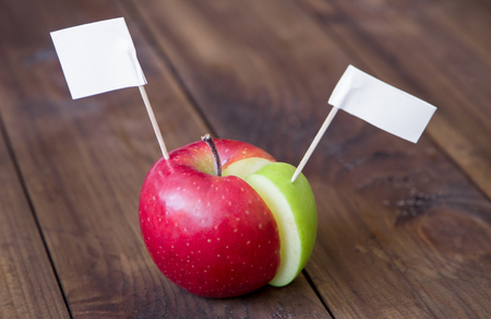 white flags thumbtack on chart made from apple. creative business concept Stock Photo