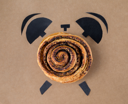 continental food: Bake with poppy in shape of alarm clock, breakfast time concept. top view Stock Photo