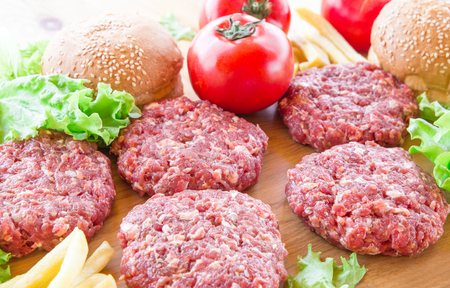 The raw ingredients for the homemade burger on country background. Top view. Stock Photo