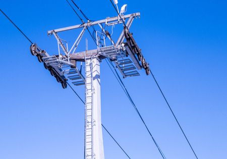 close up of cable car railway against blue sky