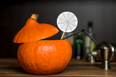 cocktail in a pumpkin. halloween drinks for party on the bar background. festive concept Stockfoto