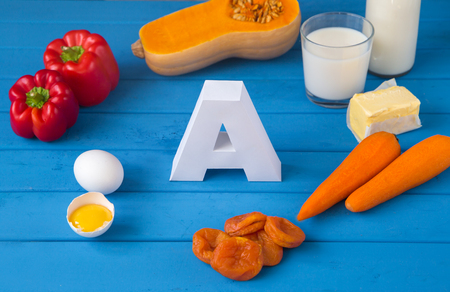 Food sources of natural vitamin A and letter A. Front view. Healthy life concept