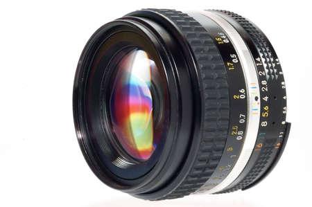 Camera lens on white background photo
