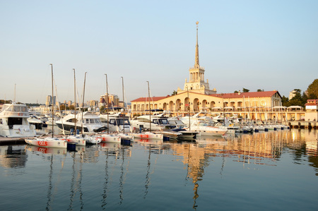 The building of the marine station and the quay with yachts